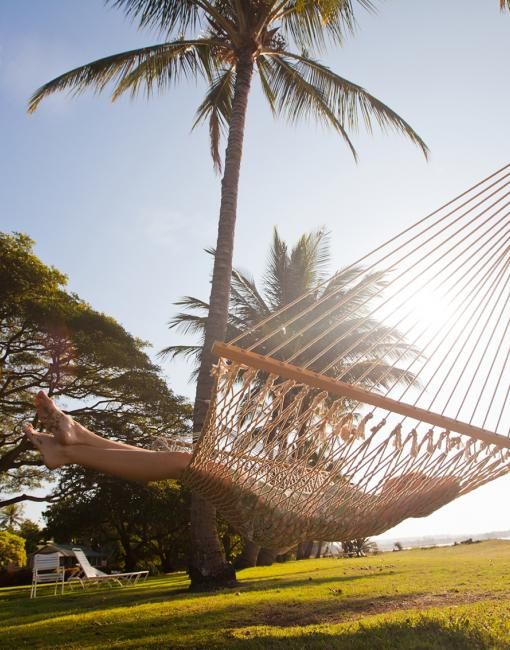 Enjoying sunny weather from a hammock in Kauai