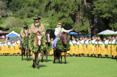 Queen Emma played by Lesah Gail Merritt rides into Kanaloahuluhulu Meadow at Kokee State Park. Her guide Kaluahi played by Norman Hookano leads her party.