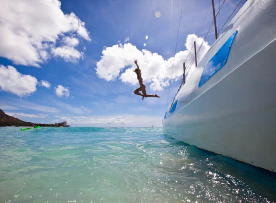 Diving off a boat in Oahu
